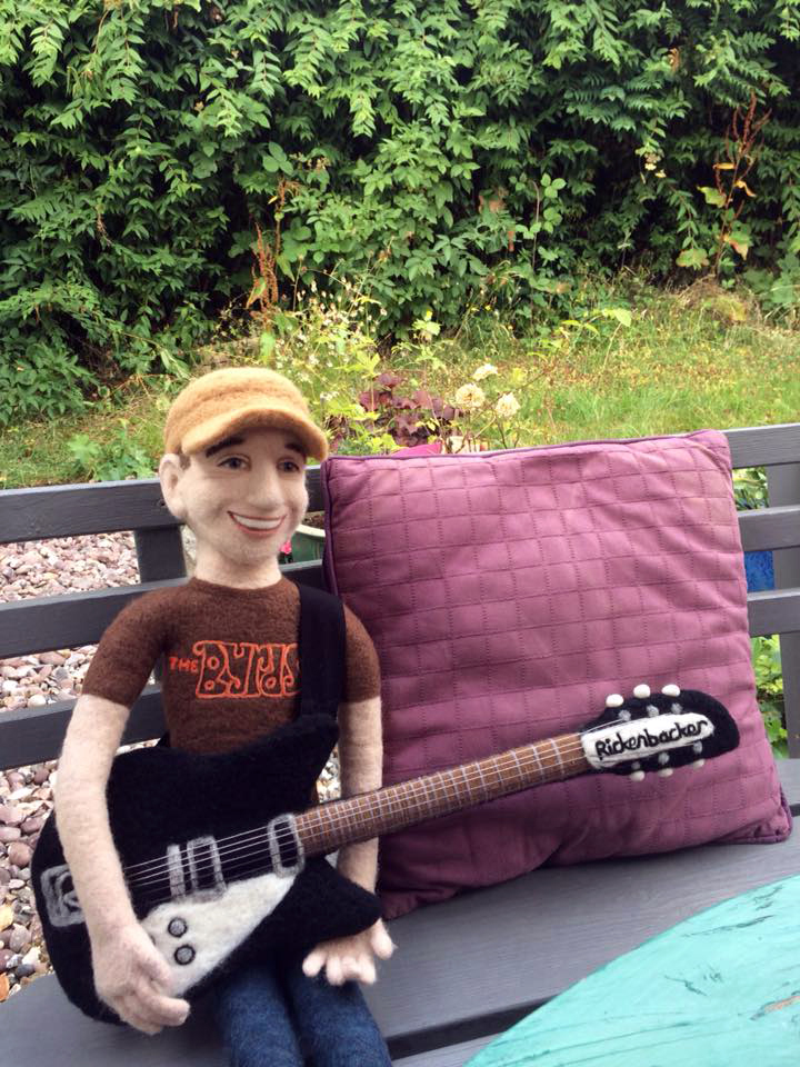 A commission piece - Fun of the Pier part time band member Richard Snow playing his Rickenbacker guitar. The piece is made from needle felted wool and is about two feet tall.